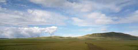 Biker in Mongolian steppe