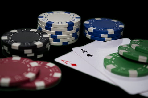 Casino poker chips sorted by colour