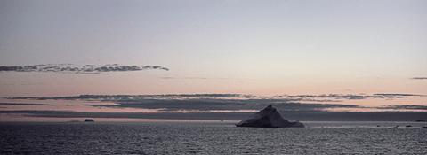 Iceberg at sunset off West Greenland coast